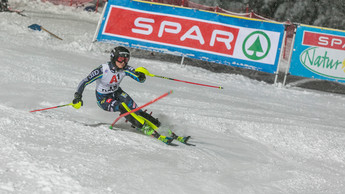 Professional ski down the slope at the World Cup in Flachau