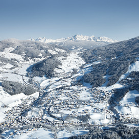 Bird's eye view of Wagrain with surrounding winter landscape and view towards Flachau at Snow Space Salzburg | © Bergbahnen AG Wagrain