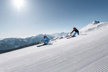 Skiers enjoy the slopes in the ski area Flachau at Snow Space Salzburg