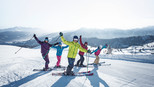 Skiers have fun during they stay in the ski area of Flachau at Snow Space Salzburg