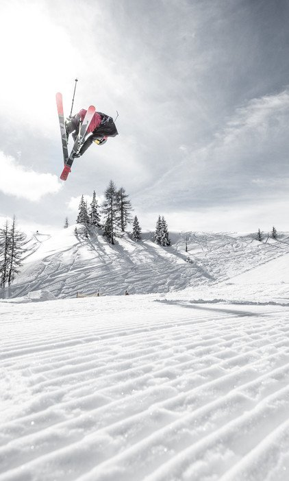 Freestyler enjoy the snowpark Alpendorf of the ski area St. Johann to the full