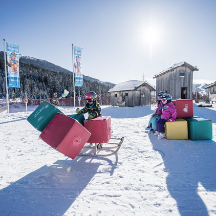 Children enjoy the skiing holiday in a playful manner in the ski area of Wagrain