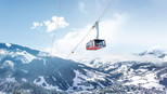 View of G-LINK, the world's biggest aerial tramway, towards the snow-covered valleys of Wagrain at Snow Space Salzburg